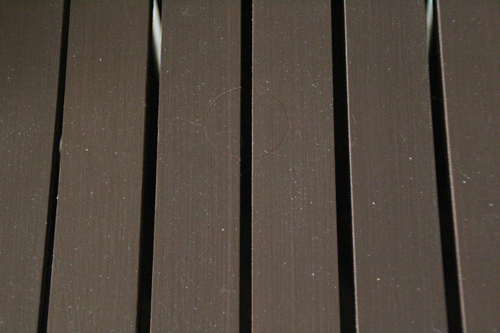 slatted table top with traced circle for umbrella