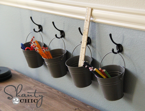 http://www.shanty-2-chic.com/2012/07/kids-art-supply-buckets-on-hooks.html