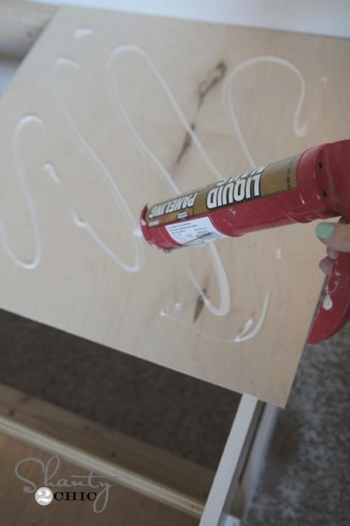 Add panel adhesive to board