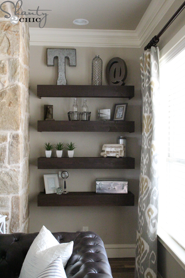 Diy floating shelves for my living room shanty 2 chic for Shelving ideas for living room walls