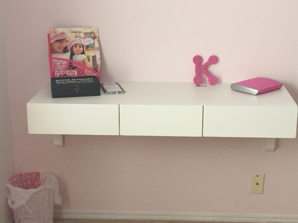 Three drawer corbel desk