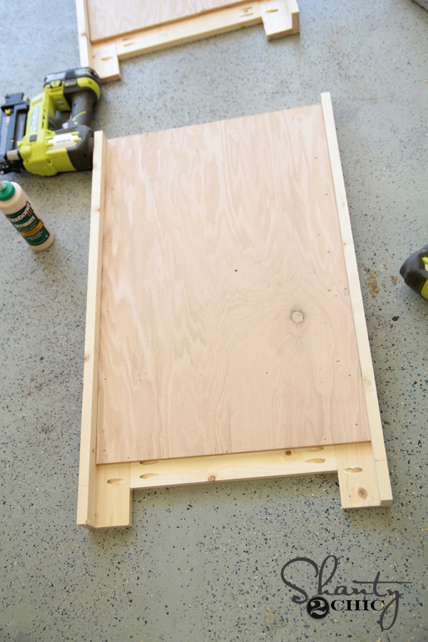 Attach plywood using wood glue and nails
