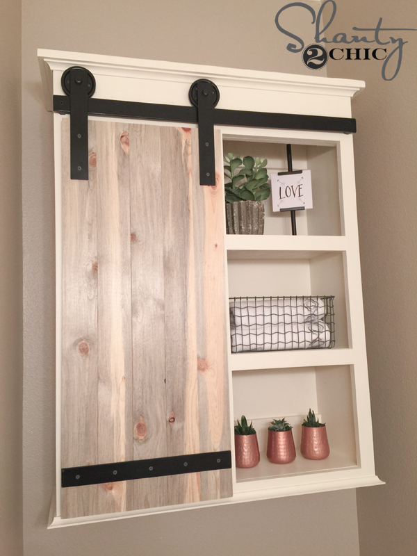 Diy sliding barn door bathroom cabinet shanty 2 chic for Bathroom cabinet organizer ideas