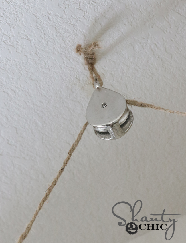 Attach pulley to ceiling