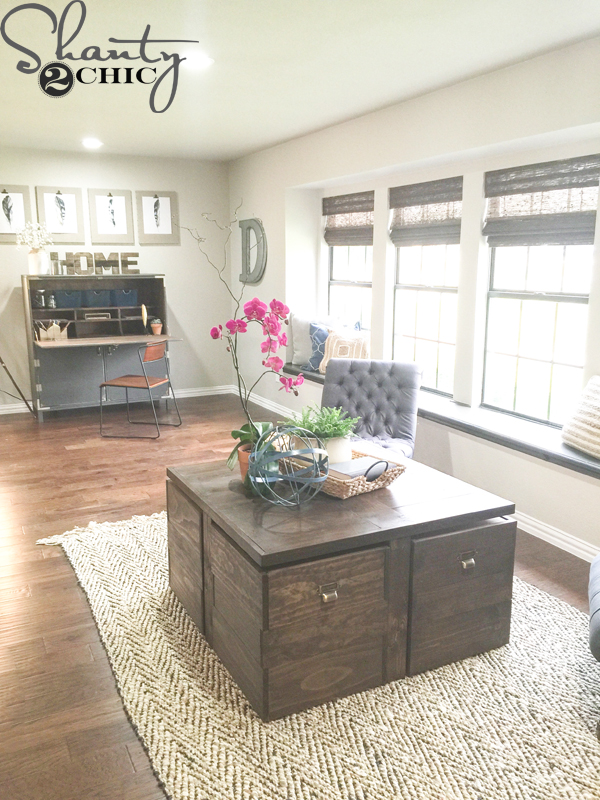 "If you caught our second episode of Open Concept on HGTV, you probably  recognize this coffee table as the ""Building Block Coffee Table"". - DIY Rolling Storage Ottoman Coffee Table - Shanty 2 Chic"