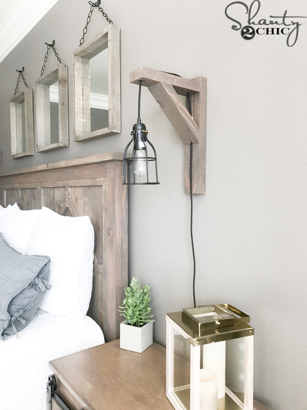 Diy corbel sconce light for 25 shanty 2 chic to hang it on the wall i used a 3 wood screw and drilled directly into the sconce below the cross piece and above the top arm aloadofball Choice Image